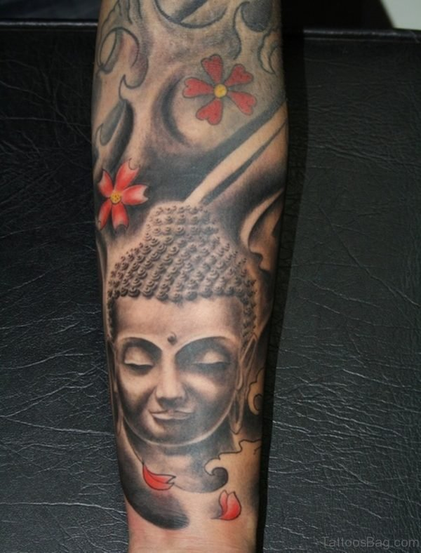 Buddha Face Flowers Tattoo On Foot