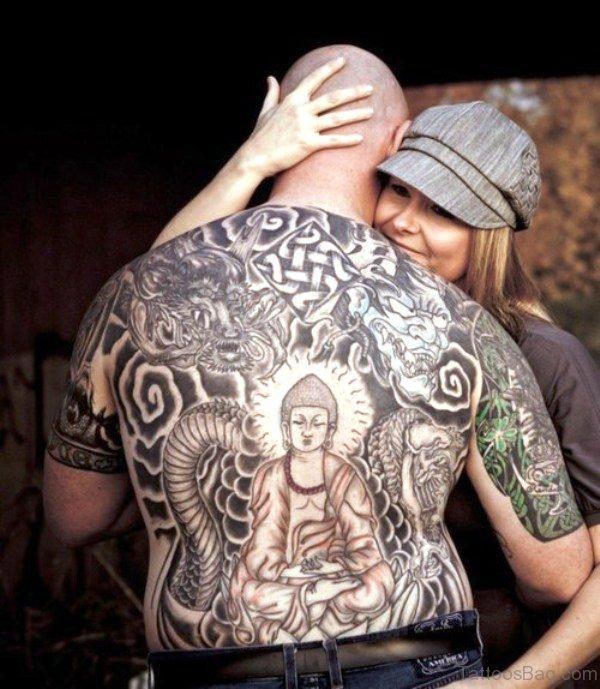 Buddha Tattoo With Devil On Back