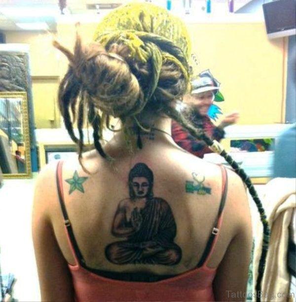 Buddha Tattoo With Nautical Star On Back