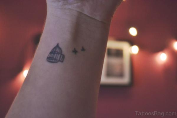 Cage And Bird Tattoo On Wrist
