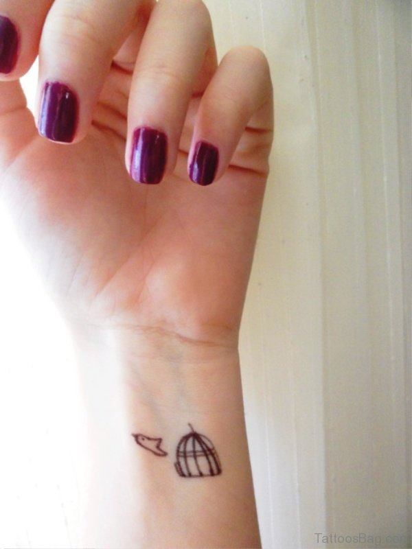 Cage Bird Tattoo On Wrist