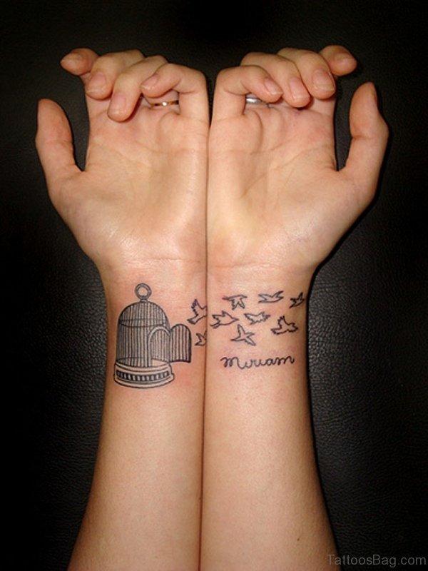 Cage With Bird Tattoo On Wrist