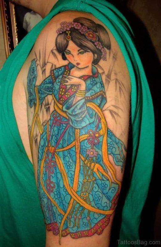 Cartoon Geisha Tattoo On Left Shoulder