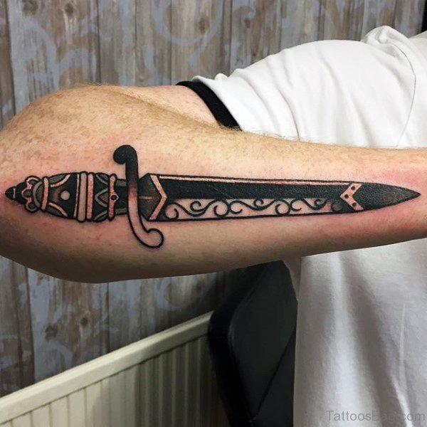 Carved Black Dagger Tattoo On Arm