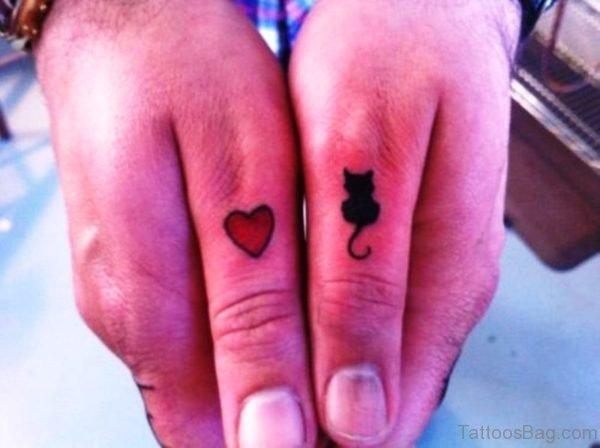 Cat And Heart Tattoo On Thumb