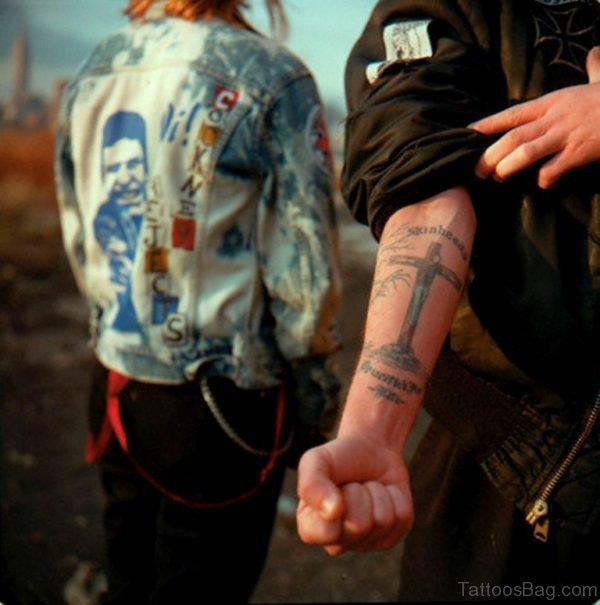 Classic Cross Tattoo On Arm