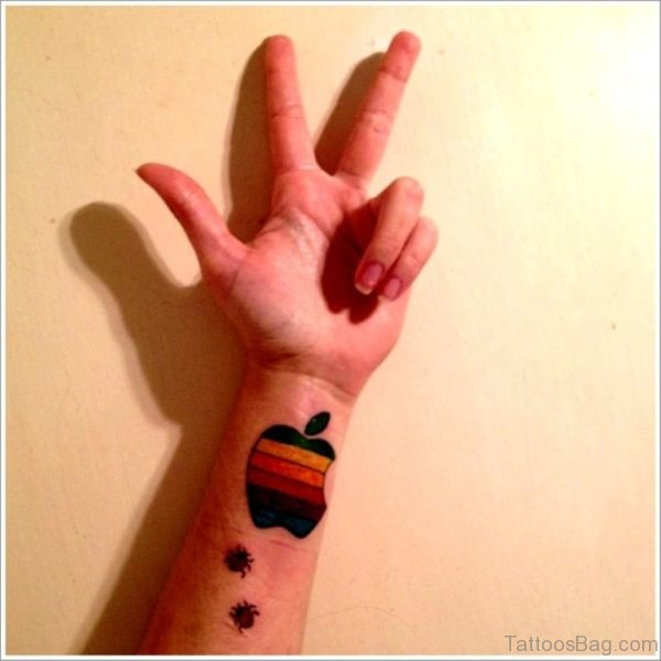 Colored Apple Logo Tattoo On Wrist