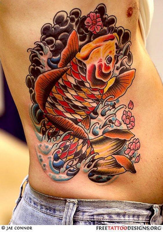 Colored Fish Tattoo On Rib