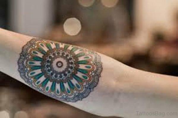 Colored Mandala Tattoo On Arm Image