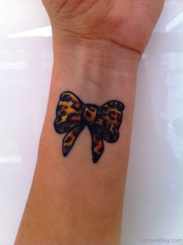 Colorful Bow Tattoo On Wrist