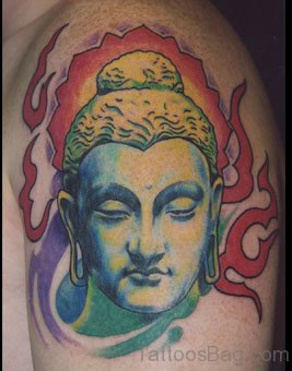 Colorful Buddhist Face Tattoo On Shoulder