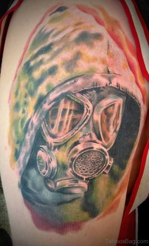 Colorful Gas Mask Tattoo On Shoulder