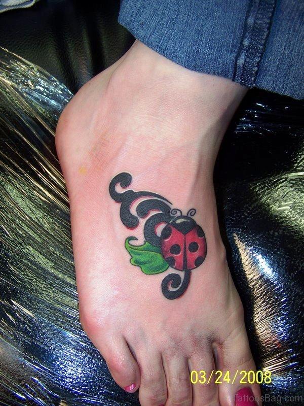 Colorful Ladybug Tattoo On Foot