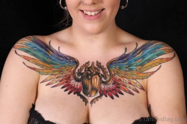 Coloured egyptian scarab with wings tattoo