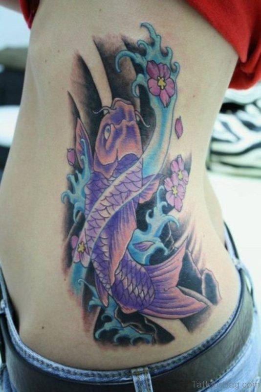 Colourful Koi Fish Tattoo On Rib