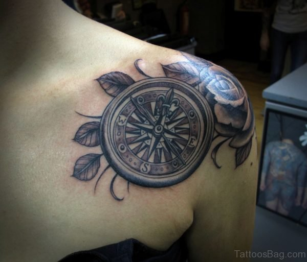 Compass And Rose Tattoo On Chest
