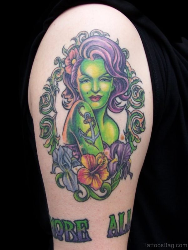 Cool colored sexy zombie girl with flowers and lettering tattoo on shoulder