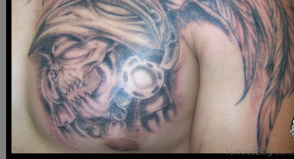 Crawling Aztec Skull Tattoo On Chest