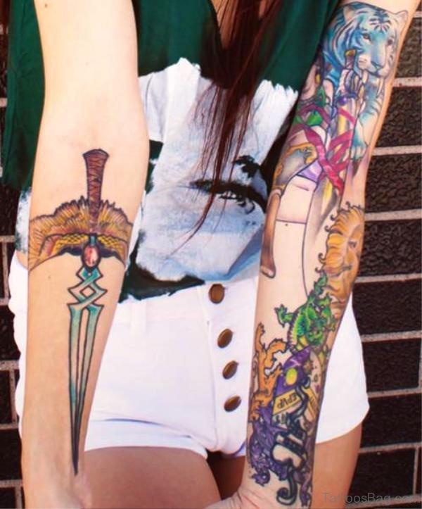 Crawling Dagger Tattoo On Arm