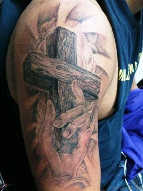 Cross In Hand Tattoo Design