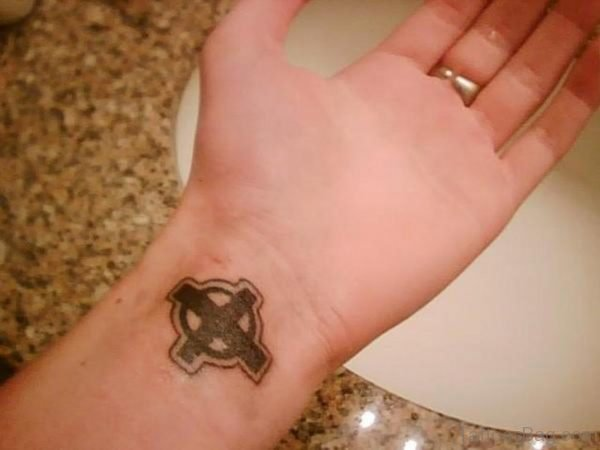 Cross Tattoo On Wrist With Lovely Design