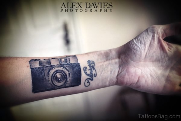 Cute Camera Wrist Tattoo Design