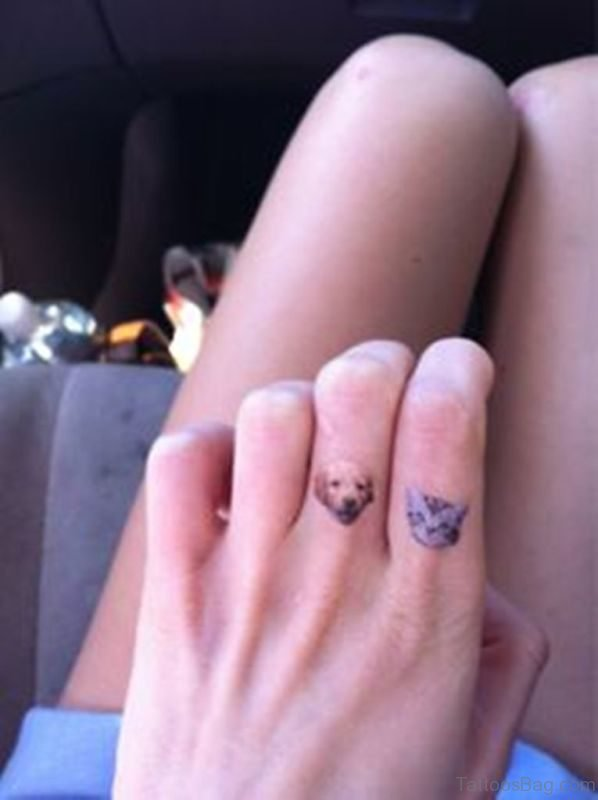 Cute Dog And Cat Tattoo On Finger