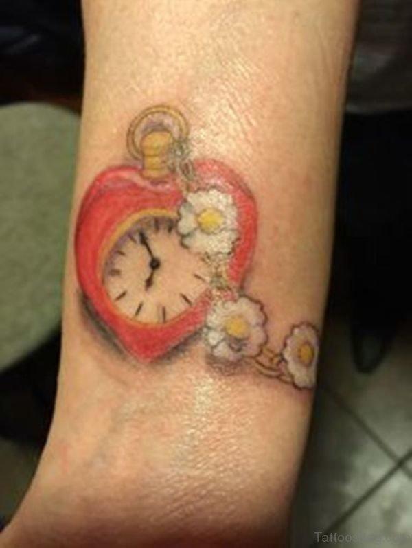 Cute Heart Clock Tattoo On Wrist