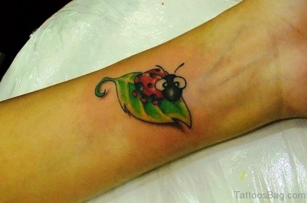 Cute Ladybug Wrist Tattoo