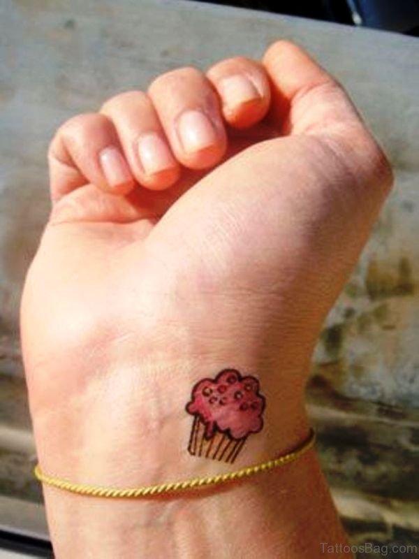 Cute Pink Cupcake Tattoo On Wrist