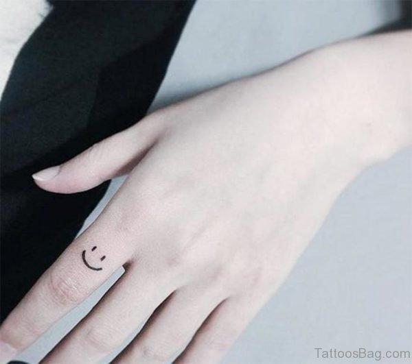 Cute Smile Symbol Tattoo On Finger