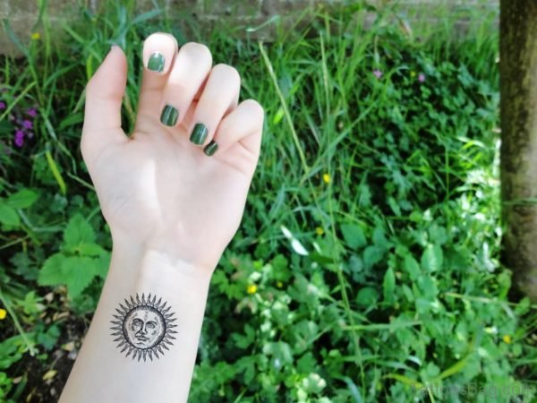 Cute Sun Tattoo On Wrist