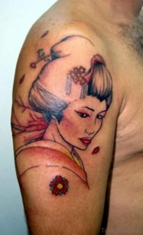 Cute colored Asian geisha tattoo on shoulder with flowers
