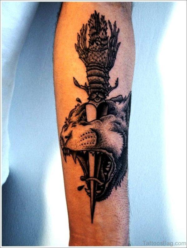 Dagger Stabbed On Tigers Head Tattoo