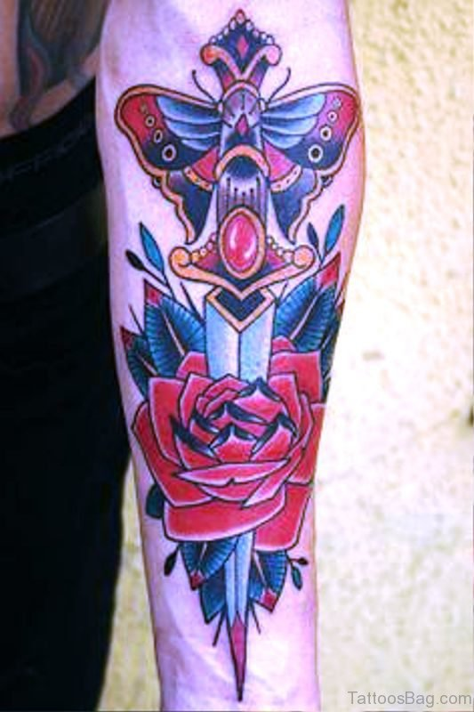 Dagger With Red Rose Tattoo On Arm