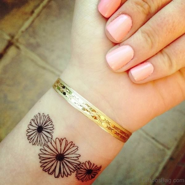 Daisy Wrist Tattoo