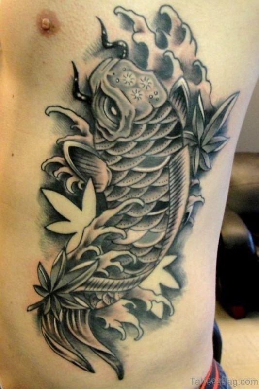 Dark Black Fish Tattoo On Rib