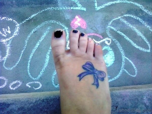 Delightful Bow Tattoo On Foot