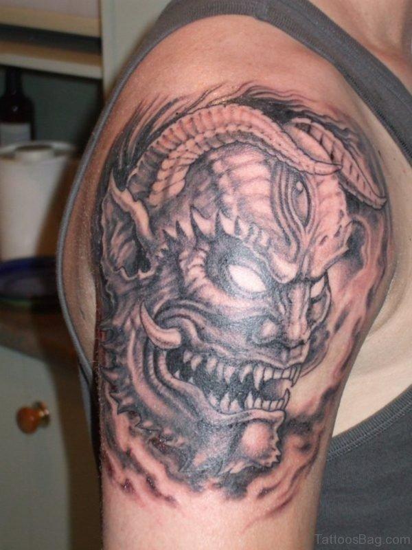 Demon Mask Tattoo On Shoulder