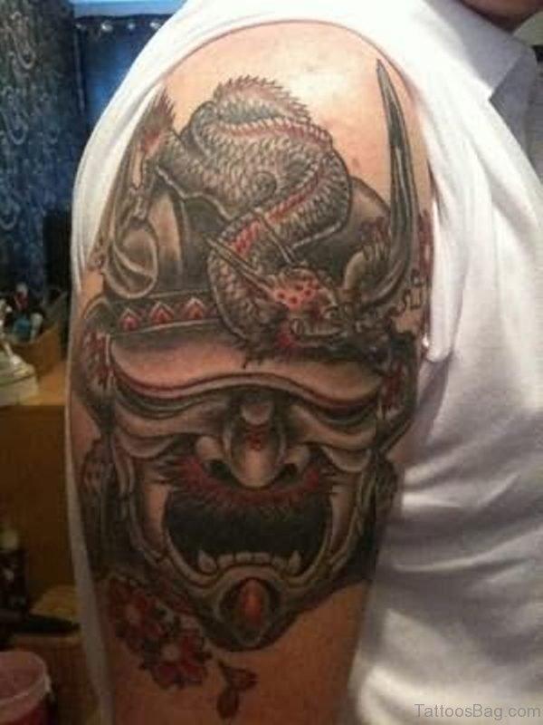 Devil Mask Tattoo On Shoulder