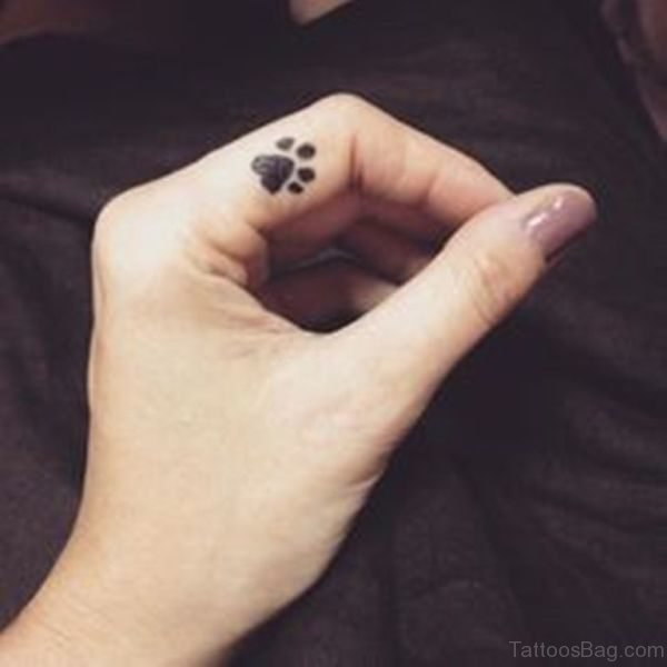 Dog Paw Tattoo On Finger