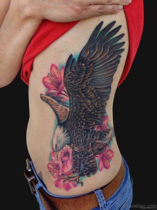 Eagle And Cherry Blossom Tattoo On Rib