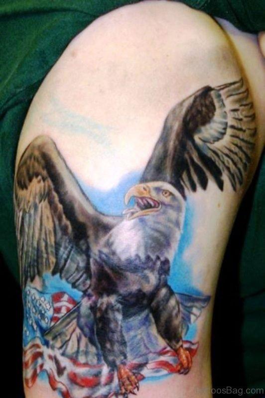 Eagle Holding American Flag Tattoo