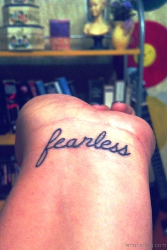 Elegant Fearless Wrist Tattoo