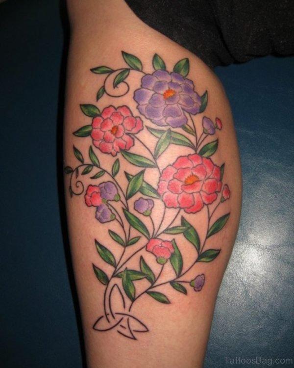 Elegant Flowers Tattoo On Thigh