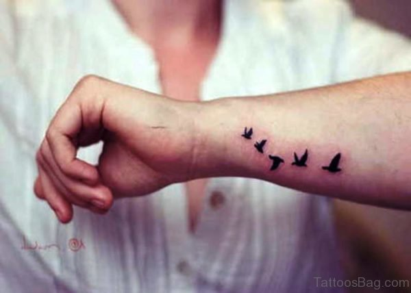 Elegant Flying Birds Tattoo On Wrist
