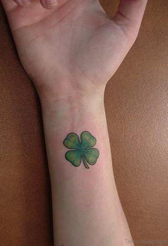 Elegant Four Leaf Tattoo On Wrist