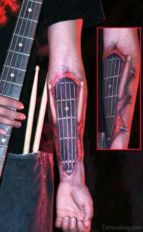 Elegant Red And Black Guitar Tattoo On Forearm