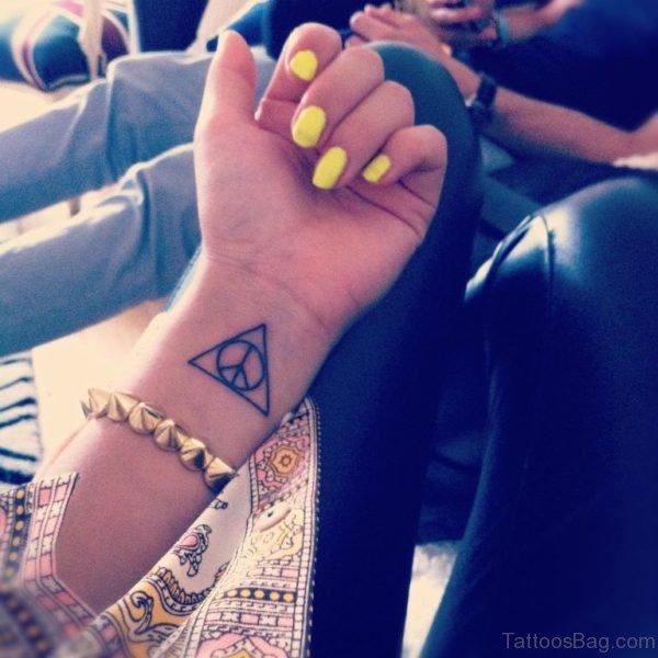 Enticing Triangle Wrist Tattoo