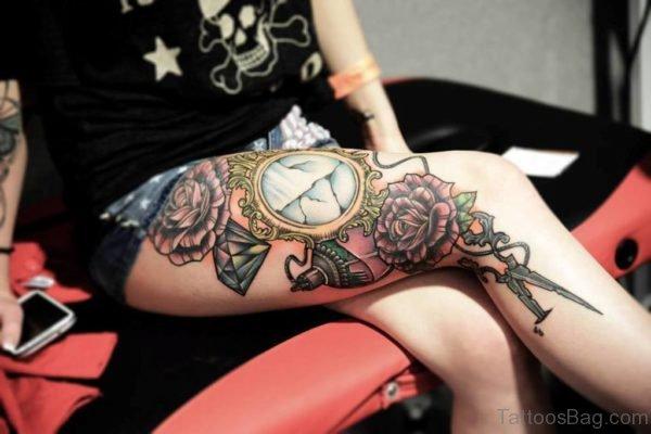 Evergreen Flower Tattoo On Thigih
